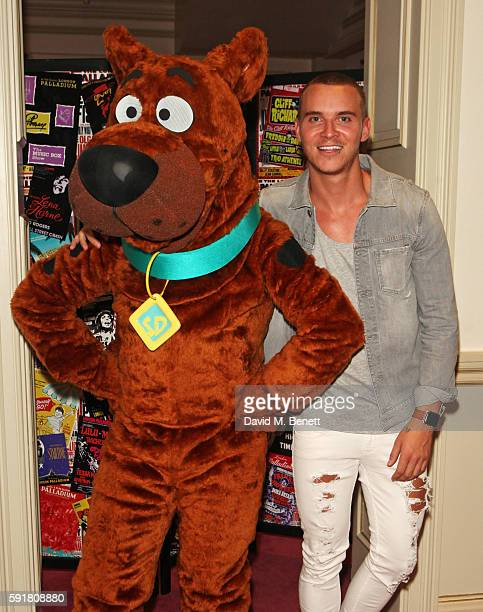 Anttix poses with ScoobyDoo at the press night after party for ScoobyDoo Live Musical Mysteries at The London Palladium on August 18 2016 in London...