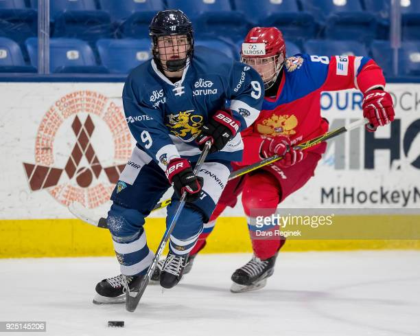 Anttoni Honka of the Finland Nationals controls the puck in front of Ivan Morozov of the Russian Nationals during the 2018 Under18 Five Nations...