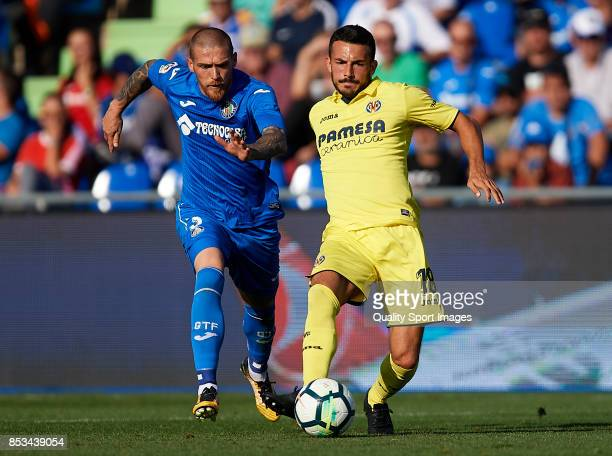 Antunes of Getafe competes for the ball with Nicola Sansone of Villarreal during the La Liga match between Getafe and Villarreal at Coliseum Alfonso...