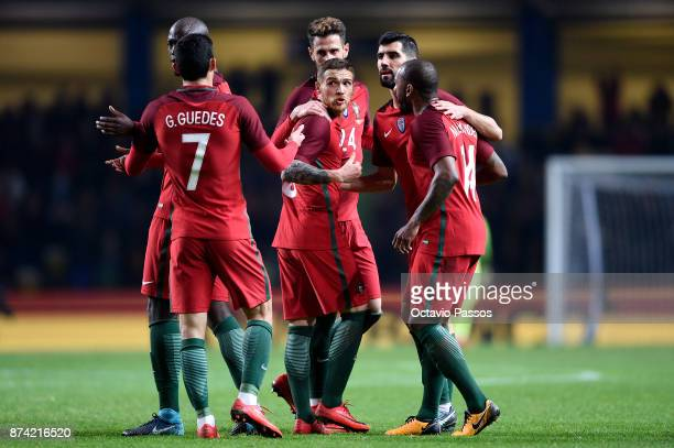 Antunes of Portugal celebrates with teammates after scoring a goal during the International Friendly match between Portugal and USA at Estadio...