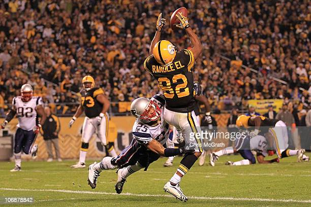 Antwaan Randle El of the Pittsburgh Steelers fumbles a catch in the endzone under pressure from Patrick Chung of the New England Patriots on November...