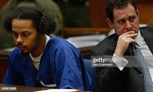 Antwaine Devon Butler looks away and his attorney Mark Werksman looks pained as Sharon Smith mother of Clive Jackson read a statement about what the...