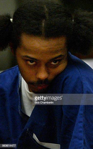 Antwaine Devon Butler rubs his cheek with his shoulder after he was sentenced to two 25–years–to– life sentences He was convicted of first–degree...
