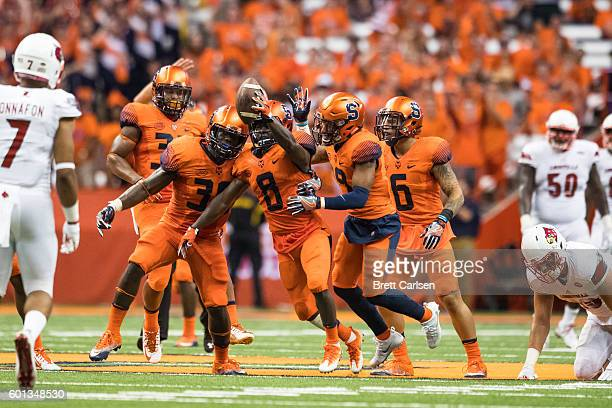 Antwan Cordy of the Syracuse Orange celebrates coming up with a turnover during the second quarter against the Louisville Cardinals on September 9...