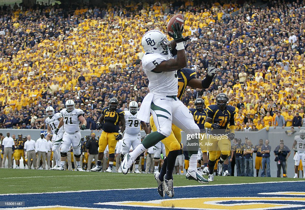 Antwan Goodley #5 of the Baylor Bears catches a seven yard touchdown pass in the fourth quarter against the West Virginia Mountaineers during the game on September 29, 2012 at Mountaineer Field in Morgantown, West Virginia. WVU defeated Baylor 70-63.