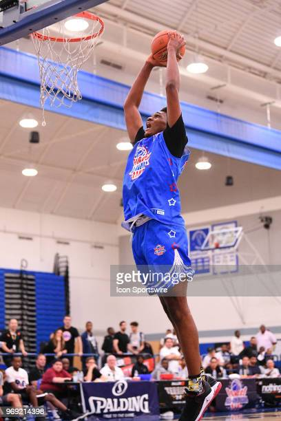 Antwan January from Santa Monica High School goes up for a dunk during the Pangos AllAmerican Camp on June 3 2018 at Cerritos College in Norwalk CA