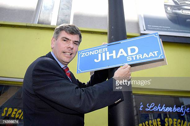 Filip Dewinter and supporters from the Belgian farright party Vlaams Belang hang a Without Jihad Street signs 30 May 2007 in Antwerp as they campaign...