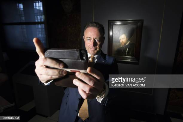 Antwerp Mayor Bart De Wever takes a selfie on April 16 2018 in front of a selfportrait of Flemish painter Rubens during the press presentation at the...