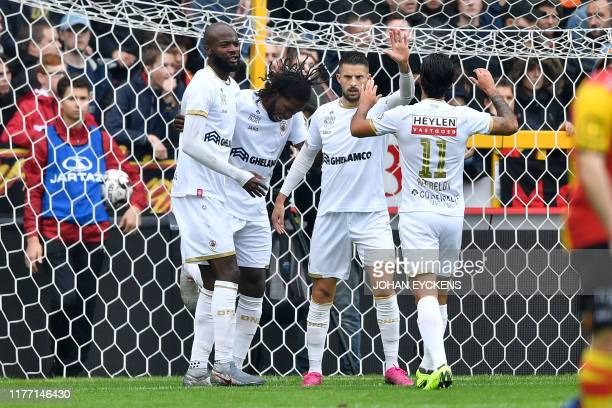 Antwerp's Didier Lamkel Ze, Antwerp's Dieumerci Mbokani Bezua, Antwerp's Kevin Mirallas and Antwerp's Lior Refaelov celebrate after scoring during a...