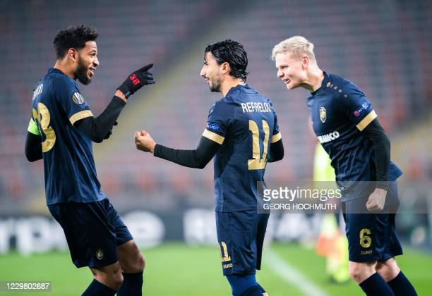 Antwerp's Israeli forward Lior Refaelov celebrates with Antwerp's Belgian midfielder Faris Haroun and Antwerp's Norwegian midfielder Simen Juklerod...