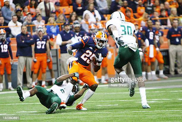 Antwon Bailey of the Syracuse Orange is tackled by Quenton Washington of the South Florida Bulls during the game at the Carrier Dome on November 11...
