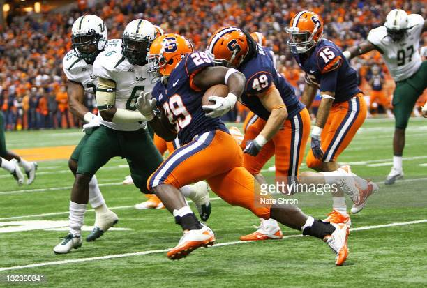 Antwon Bailey of the Syracuse Orange runs the ball against Kayvon Webster of the South Florida Bulls during the game at the Carrier Dome on November...