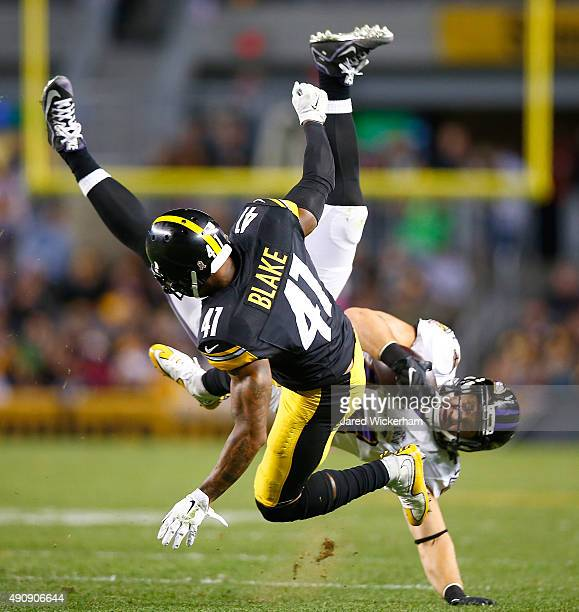 Antwon Blake of the Pittsburgh Steelers tackles Kyle Juszczyk of the Baltimore Ravens after making a catch during the game at Heinz Field on October...