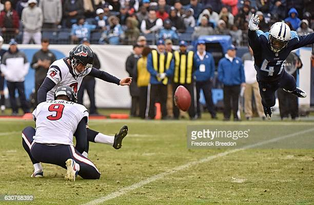Antwon Blake of the Tennessee Titans dives attempting to block an extra point by Nick Novak of the Houston Texans during the second half at Nissan...