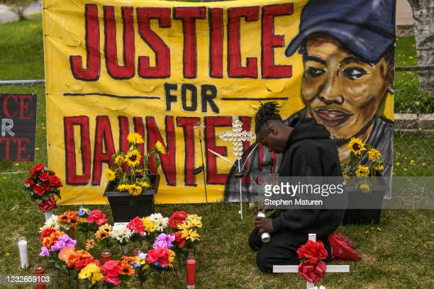 Antwon Davis lights candles at a memorial for Daunte Wright on May 2, 2021 in Brooklyn Center, Minnesota. Twenty-year-old Daunte Wright was shot and...