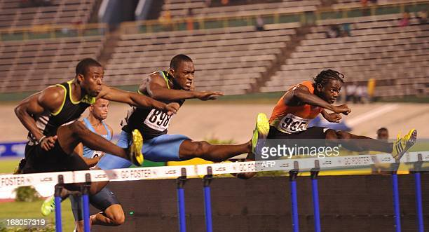 Antwon Hicks of the United States clocked 4515 seconds to win the men's 110 hurdles and amaicans Andrew Riley in 1328 placed third and Hansle...