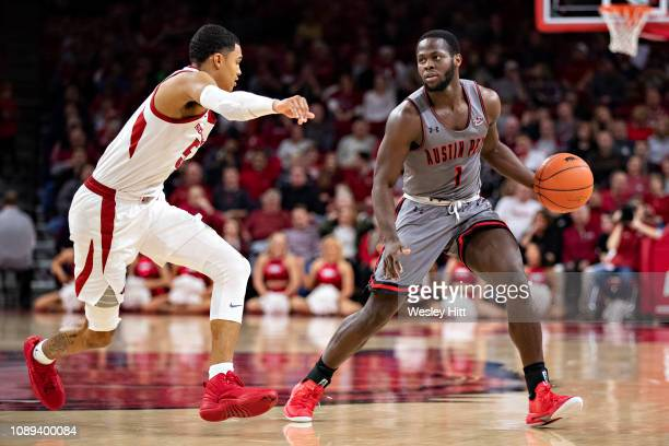 Antwuan Butler of the Austin Peay Governors drives against Jalen Harris of the Arkansas Razorbacks at Bud Walton Arena on December 28 2018 in...