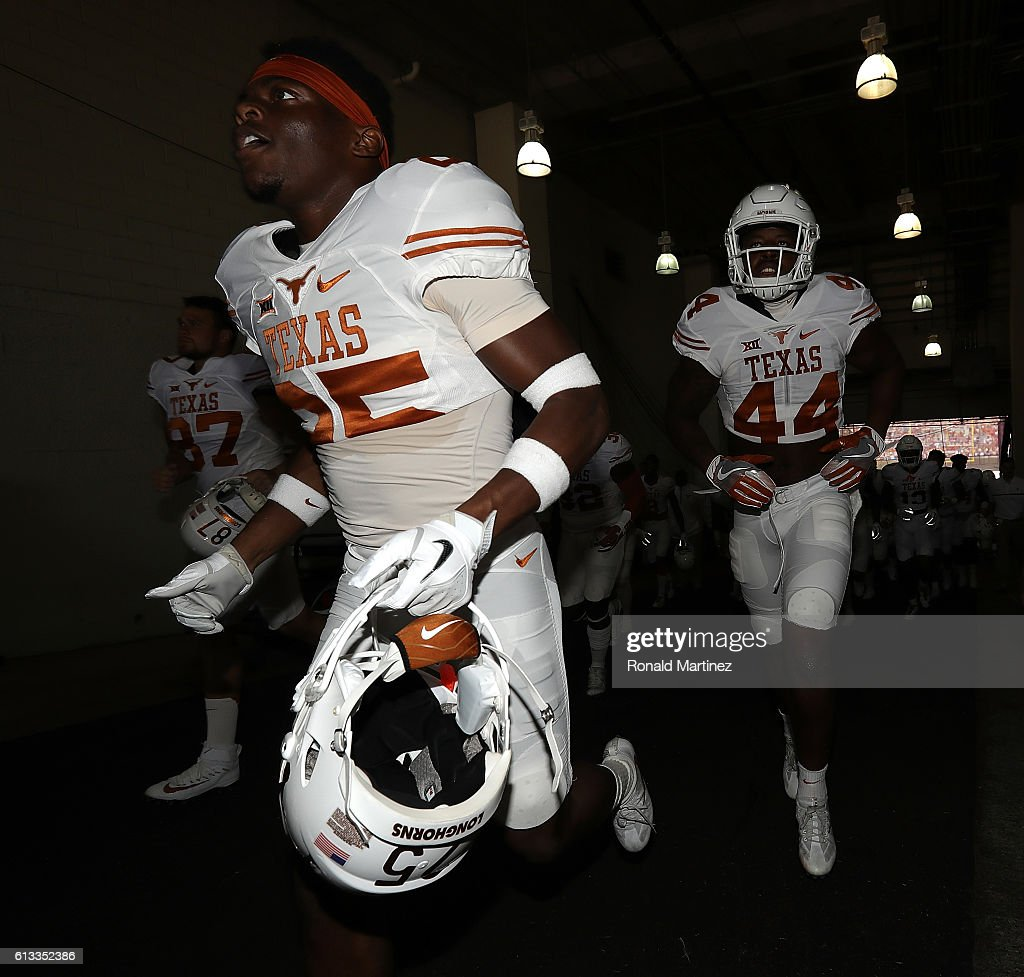 Antwuan Davis #25 of the Texas Longhorns runs off the field before a game against the Oklahoma Sooners at Cotton Bowl on October 8, 2016 in Dallas, Texas.