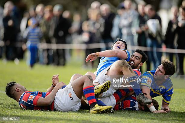 Anty Burnett of Lincoln University is tackled during the Hawkins Division 1 Trophy Semi Final match between Lincoln University and Sydenham RC on...