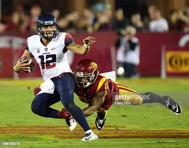 Anu Solomon of the Arizona Wildcats avoids a tackle from Su'a Cravens of the USC Trojans during the first quarter Los Angeles Coliseum on November 7,...