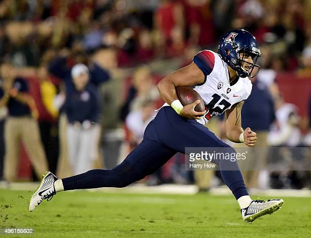 Anu Solomon of the Arizona Wildcats dives for a first down during the first quarter against the USC Trojans at Los Angeles Coliseum on November 7,...