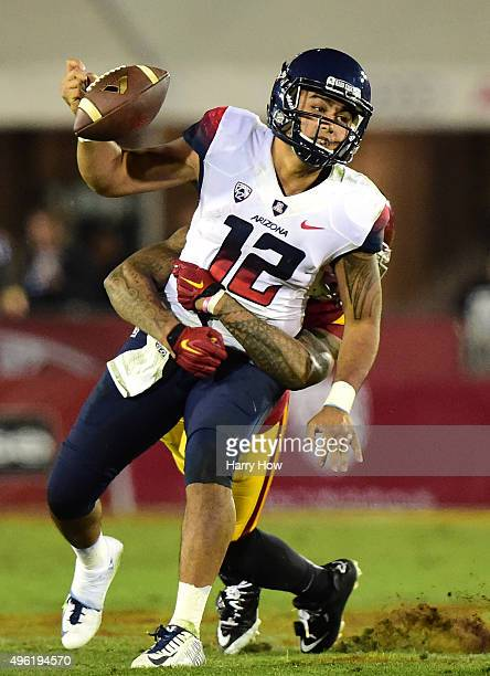 Anu Solomon of the Arizona Wildcats fumbles from a tackle by Su'a Cravens of the USC Trojans during the third quarter at Los Angeles Coliseum on...