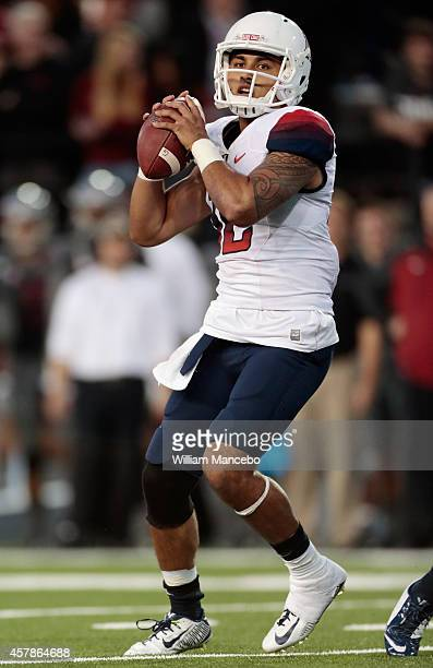 Anu Solomon of the Arizona Wildcats looks to pass against the Washington State Cougars during the game at Martin Stadium on October 25, 2014 in...