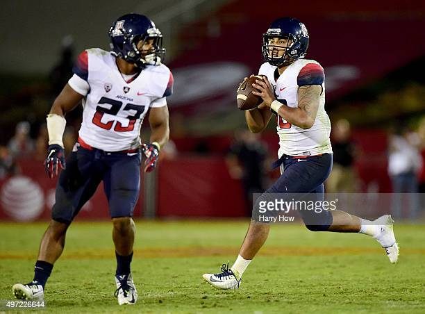Anu Solomon of the Arizona Wildcats rolls out of the pocket behind Jared Baker during the game against the USC Trojans at Los Angeles Coliseum on...