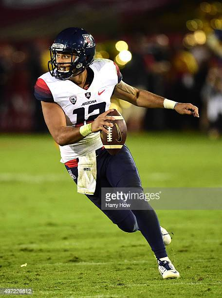 Anu Solomon of the Arizona Wildcats scrambles out of the pocket during the game against the USC Trojans at Los Angeles Coliseum on November 7, 2015...