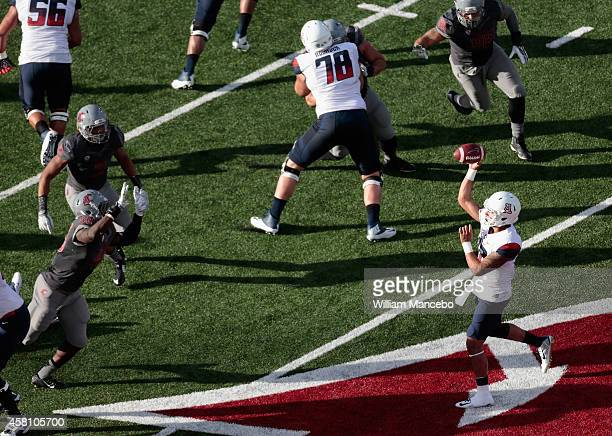 Anu Solomon of the Arizona Wildcats throws a pass against the Washington State Cougars during the game at Martin Stadium on October 25, 2014 in...