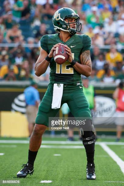 Anu Solomon of the Baylor Bears drops back to pass against the Liberty Flames during a football game at McLane Stadium on September 2, 2017 in Waco,...