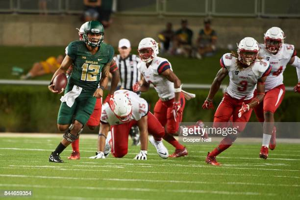 Anu Solomon of the Baylor Bears scrambles against the Liberty Flames during a football game at McLane Stadium on September 2, 2017 in Waco, Texas.