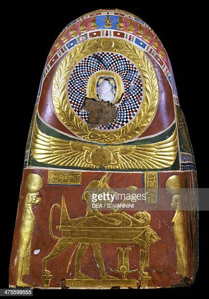 Anubis in the throes of performing the ritual of embalming decorative detail of a male funeral mask painted and gilded cartonnage from Meir Egyptian...