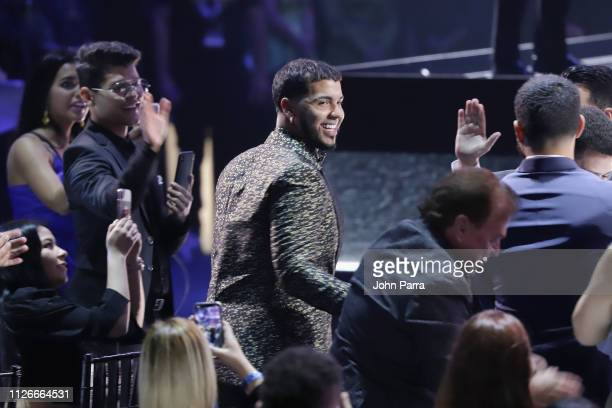 Anuel AA accepts an award on stage at Univision's 31st Edition Of Premio Lo Nuestro A La Musica Latin at American Airlines Arena on February 21 2019...