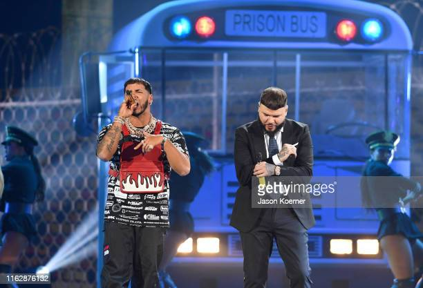 Anuel AA and Farruko perform on stage during Premios Juventud 2019 at Watsco Center on July 18 2019 in Coral Gables Florida