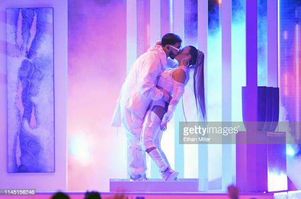 Anuel AA and Karol G kiss as they perform during the 2019 Billboard Latin Music Awards at the Mandalay Bay Events Center on April 25 2019 in Las...