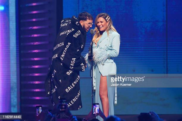 Anuel AA and Karol G on stage during Premios Juventud 2019 at Watsco Center on July 18 2019 in Coral Gables Florida