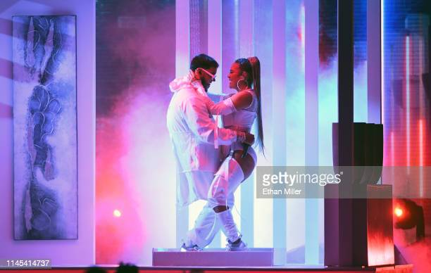 Anuel AA and Karol G perform during the 2019 Billboard Latin Music Awards at the Mandalay Bay Events Center on April 25, 2019 in Las Vegas, Nevada.