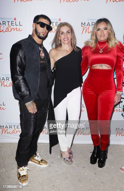 Anuel AA, Leila Cobo and Karol G attend the T.J. Martell 2019 Miami Dinner at Estefan Kitchen on February 20, 2019 in Miami, Florida.