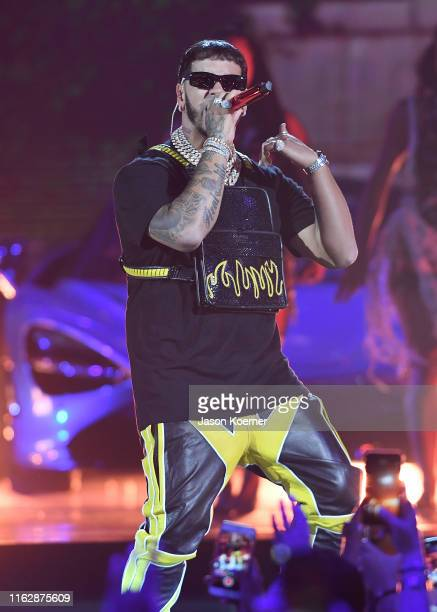 Anuel AA performs on stage during Premios Juventud 2019 at Watsco Center on July 18 2019 in Coral Gables Florida
