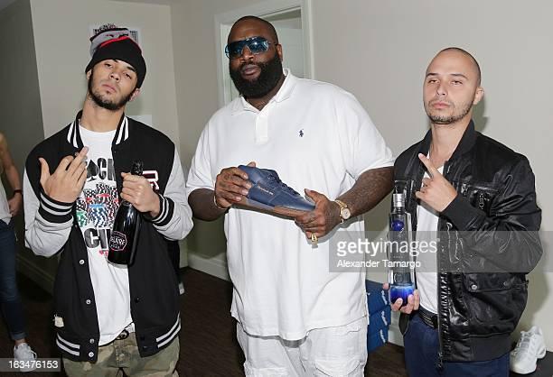 Anuel Rick Ross and RKO are seen at the Reebok Classic gifting suite at Rick Ross' white party at Fontainebleau Hotel on March 10 2013 in Miami Beach...