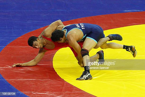 Anuj Kumar of India competes against Muhammad Inam of Pakistan in the men's 84kg freestyle gold medal wrestling at IG Sports Complex during day seven...