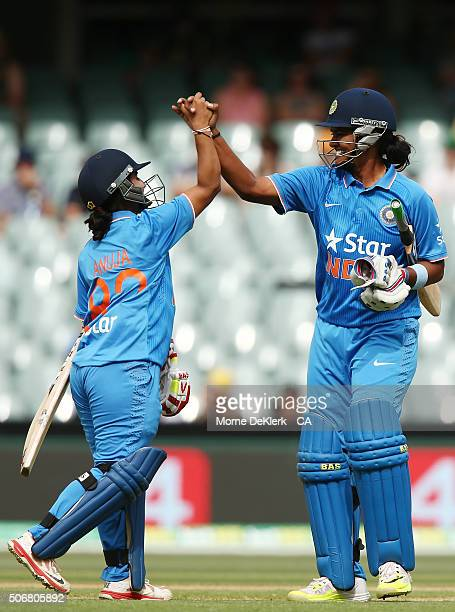Anuja Patil and Shikha Pandey of India celebrate after winning the women's Twenty20 International match between Australia and India at Adelaide Oval...