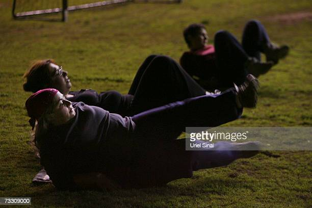 Anuk Yosef and Yifat Shnaider overweight Israeli women warm up during their soccer practice as part of a weightloss program based on the sport on...