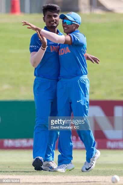 Anukul Roy and Captain Prithvi Shaw of India celebrate the wicket of Captain Liam Roche of Zimbabwe during the ICC U19 Cricket World Cup match...