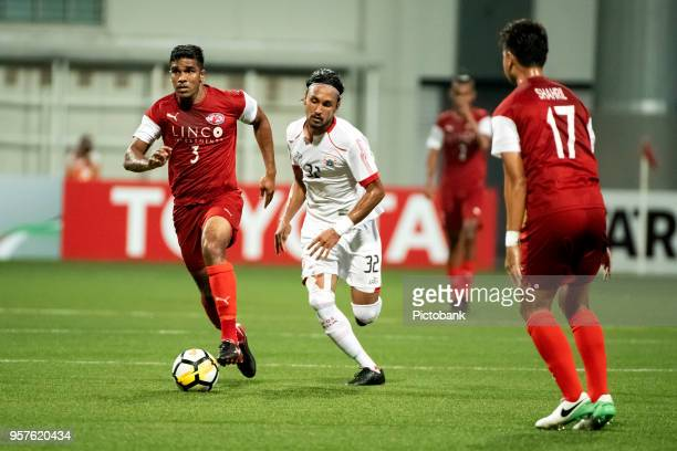 Anumanthan Kumar of Home United is pursued by Rohit Chand of Persija Jakarta during the AFC Cup Zonal Semi final between Home United and Persija...
