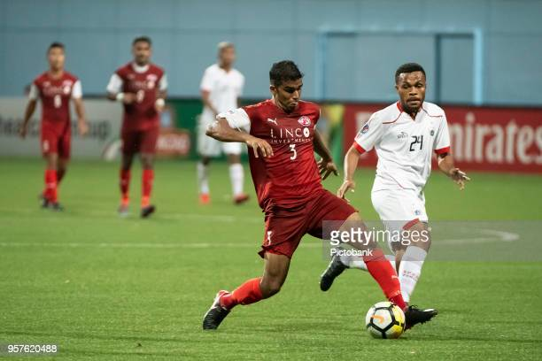 Anumanthan Kumar of Home United is pursued by Yan Pieter of Persija Jarkarta during the AFC Cup Zonal Semi final between Home United and Persija...