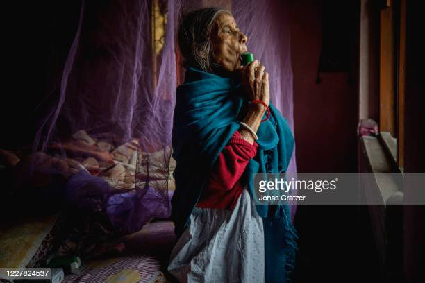 Anunadha Das, 78 years old, is inhaling her asthma -medicine. She recently started to suffering from asthma as many other people in her...