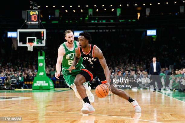 G Anunboy of the Toronto Raptors drives past Gordon Hayward of the Boston Celtics in the first half at TD Garden on October 25 2019 in Boston...