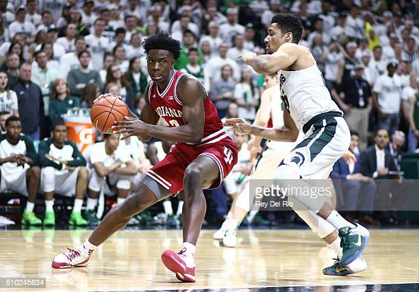 Anunoby of the Indiana Hoosiers drives around against Kenny Goins of the Michigan State Spartans in the first half at the Breslin Center on February...